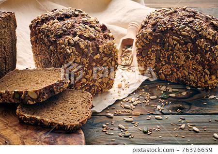 Homemade bread on dark wooden table 76326659