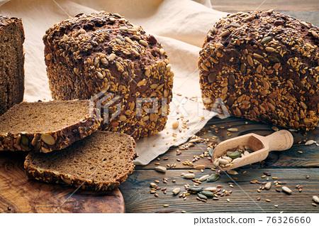 Homemade bread on dark wooden table 76326660