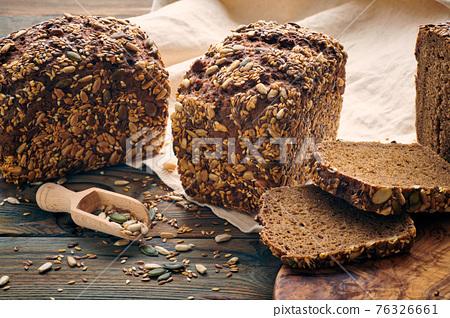 Homemade bread on dark wooden table 76326661