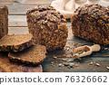 Homemade bread on dark wooden table 76326662