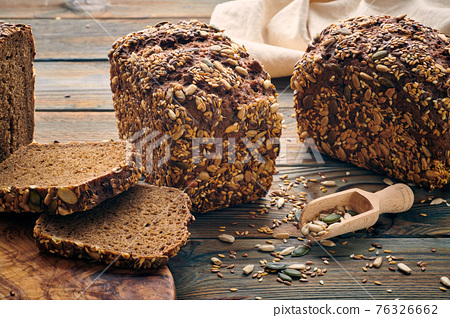 Homemade bread on dark wooden table 76326662