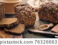 Homemade bread on dark wooden table 76326663