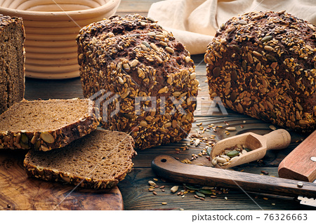 Homemade bread on dark wooden table 76326663