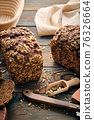 Homemade bread on dark wooden table 76326664