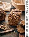 Homemade bread on dark wooden table 76326665