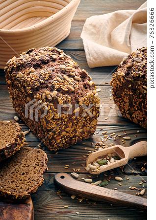 Homemade bread on dark wooden table 76326666