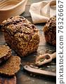 Homemade bread on dark wooden table 76326667