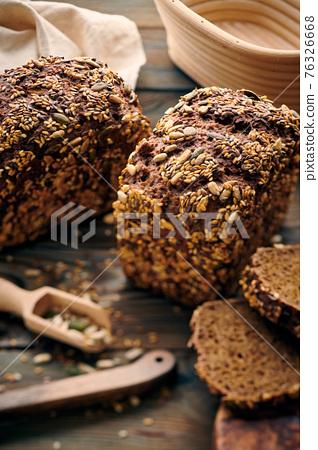Homemade bread on dark wooden table 76326668