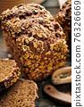 Homemade bread on dark wooden table 76326669