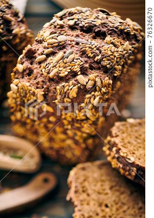 Homemade bread on dark wooden table 76326670