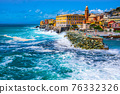 rough sea big waves crash on small port of Nervi in Genoa in Italian Riviera of liguria in beautiful 76332326