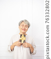 Senior asian woman happy smile hold gift box in hands. 76332802