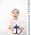 Senior asian woman happy smile hold gift box in hands. 76332803