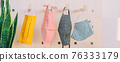 Fabric face masks hanging on closet hooks. Many colors and patterns to make your own mask at home for corona virus prevention. Panoramic banner. 76333179