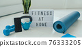 Fitness at home lightbox sign in living room for online workout on phone app training indoors with dumbbell weights and resistance bands on yoga mat banner background. 76333205
