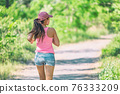 Runner running outdoor wearing protective face mask during active workout outside for COVID-19 prevention in public. Outdoor summer lifestyle. 76333209