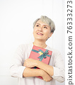 Senior asian woman happy smile hold gift box in hands. 76333273