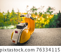 background with old toy scooter in vintage Italian style 76334115