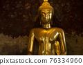 Ancient buddha statue at Wat Suthat temple ,Bangkok ,Thailand 76334960
