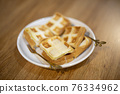 Thai Dessert ; Toast with milk topping on table 76334962