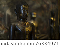 Ancient buddha statue as background 76334971