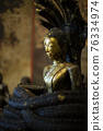 Ancient buddha and snake statue as background 76334974