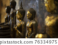 Ancient buddha statue as background 76334975