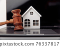 Wooden gavel and house on a laptop close-up. Real estate mortgage auction 76337817