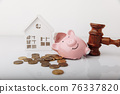 Wooden gavel, broken piggy bank and house model with coins. Real estate auction concept 76337820