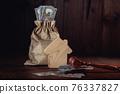 Bag of money, house and gavel 76337827