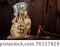 Dollar money bag and judge's gavel. Lawyer services. Protection of rights 76337829