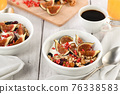 Breakfast. Muesli with oatmeal, figs and dried fruits 76338583
