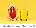 woman with suitcase going traveling on yellow background. 76339639