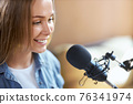 Cute woman communicating on radio or live broadcast. 76341974