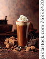Truffles and glass of hot chocolate with whipped cream. 76353420