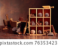 Chocolate truffles with broken pieces of chocolate and spices in wooden box. 76353423