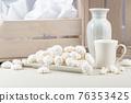 Small white meringues . 76353425