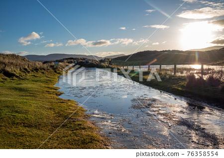 Frozen water on the way to Kiltoorish bay beach between Ardara and Portnoo in Donegal - Ireland. 76358554