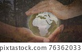 Composition of man holding globe with forest in background 76362033