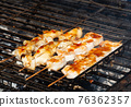 The barbecuing squid on skewers with spicy sauce 76362357