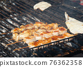 The barbecuing squid on skewers with spicy sauce 76362358