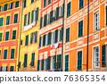 Italian style windows orange yellow buildings intense colorful background texture 76365354