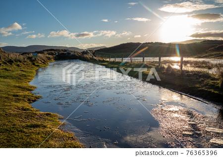 Frozen water on the way to Kiltoorish bay beach between Ardara and Portnoo in Donegal - Ireland. 76365396