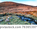 Winter sunset at the Glenveagh National Park in County Donegal - Ireland 76365397
