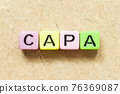 Color alphabet letter block in word CAPA (abbreviation of corrective action and preventive action) on wood background 76369087