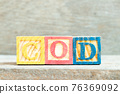 Color alphabet letter block in word COD (Abbreviation of cash on delivery or cash on demand) on wood background 76369092