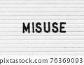 Black color letter in word misuse on white felt board background 76369093