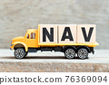 Toy truck hold alphabet letter block in word NAV (Abbreviation of Net asset value) on wood background 76369094