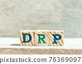 Alphabet letter block in word DRP (Abbreviation of Disaster recovery plan, Distribution resource planning, Dividend reinvestment plan, Direct Repair Program or Digital Remaster Processing) on wood 76369097