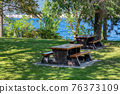 Recreation area with beautiful overview of the lake and mountains 76373109